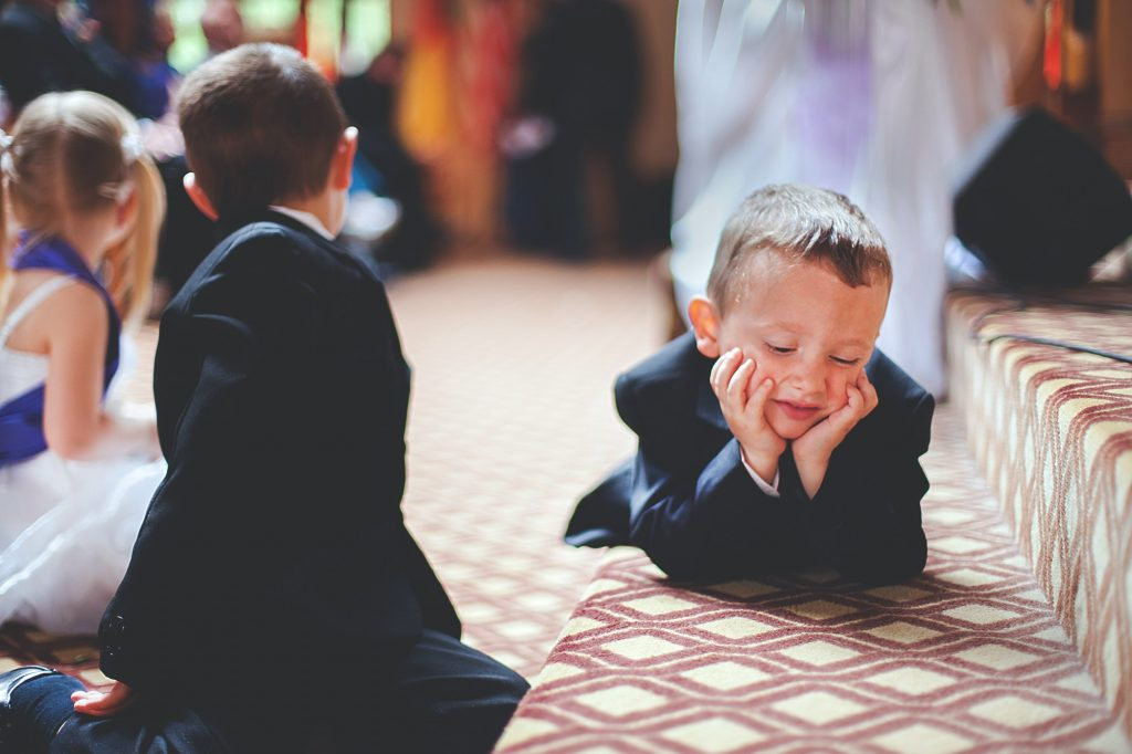 Kids bored at the wedding ceremony