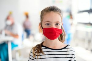 Portrait of child with face mask, coronavirus, covid-19 and vaccination concept