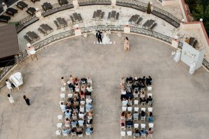 wedding ceremony area with rows of guests top view